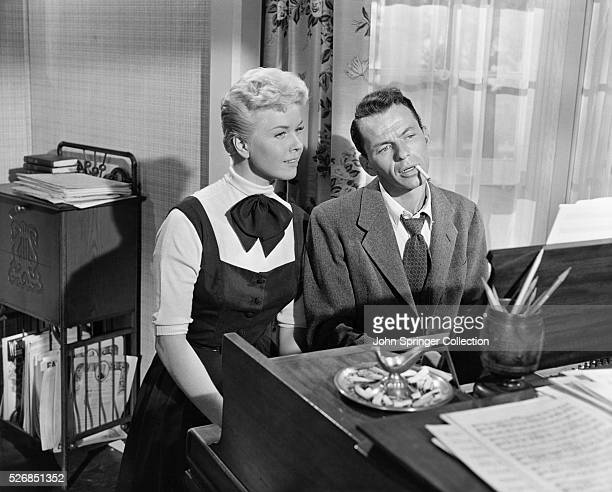 Doris Day and Frank Sinatra singing at the piano in the film Young at Heart