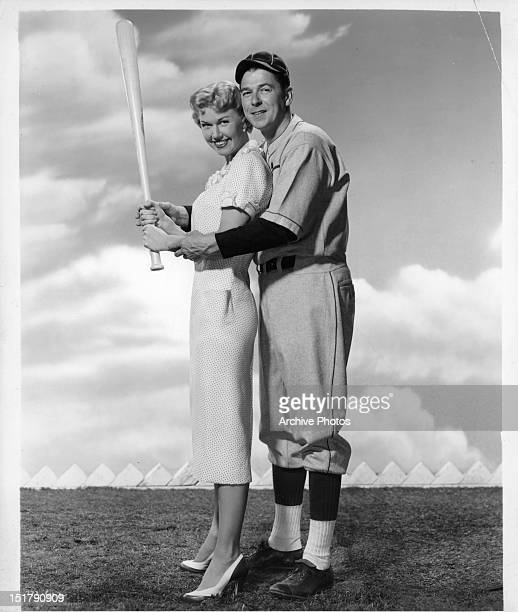 Doris Day and Ronald Reagan posing in a promotional portrait for the film 'The Winning Team' 1952