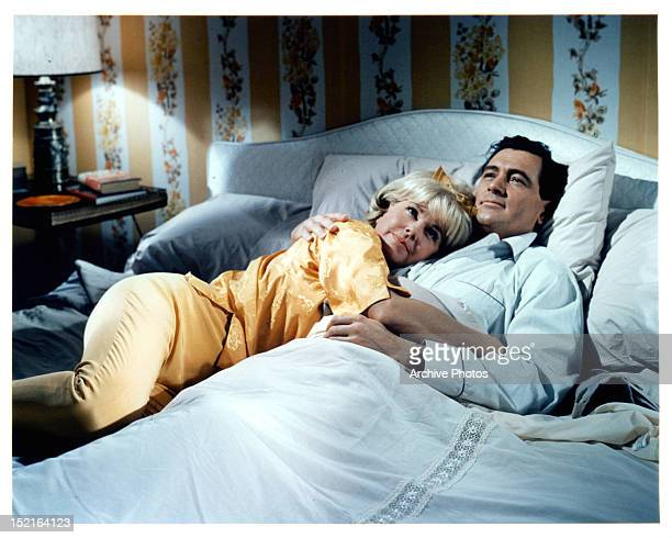 Doris Day lies in the arms of Rock Hudson in a scene from the film 'Send Me No Flowers', 1964.