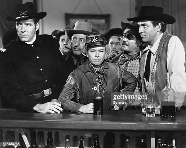 Doris Day Philip Carey and Howard Keel in the Warner Bros movie Calamity Jane directed by David Butler