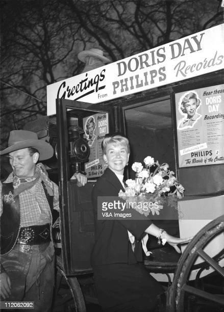 Doris Day posed at Philips Records reception at Claridges getting into carriage 1956