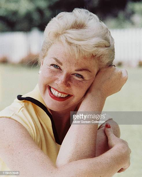 Doris Day US actress and singer smiling and resting her head against her arm circa 1960