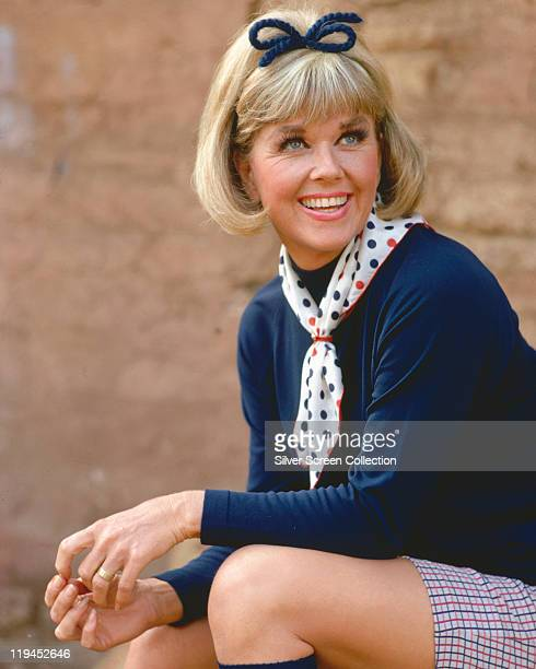 Doris Day US actress and singer wearing a red white and blue polka dot neckscarf and a dark blue jumper with a dark blue bow in her hair circa 1965