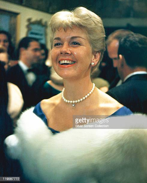 Doris Day US actress and singer wearing a white fur stole and a white pearl necklace circa 1965