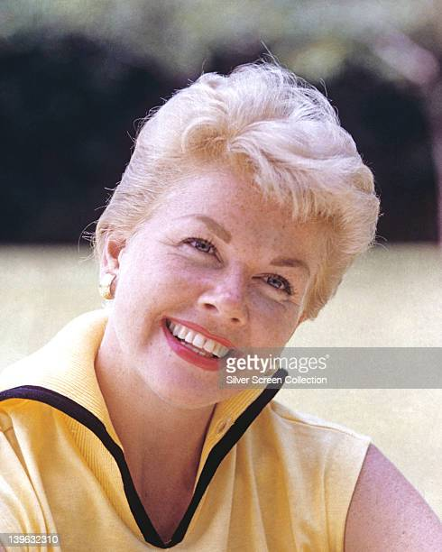 Doris Day US actress and singer wearing a yellow sleeveless top with black trim on the neck circa 1965