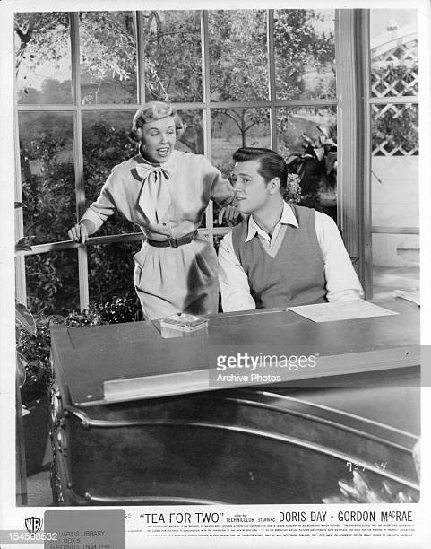 Doris Day watches as Gordon MacRae plays piano in a scene from the film 'Tea For Two' 1950