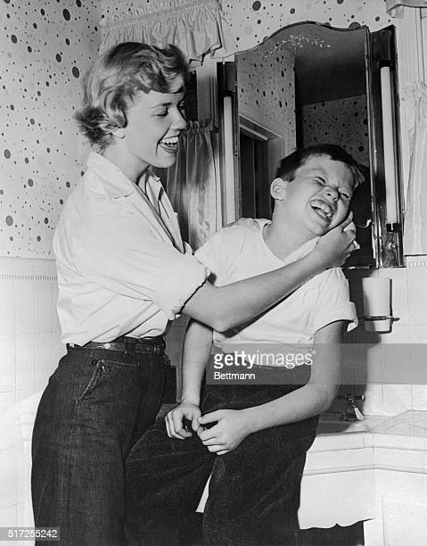 Doris Day who portrays glittery glamour girls on the screen is actually a devoted mother in private life What is more she has launched a onewoman...