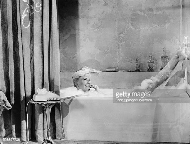 Doris Day's morning bath is made delightful when she gets a call from Rock Hudson with whom she's much in love A scene from Pillow Talk a gay...