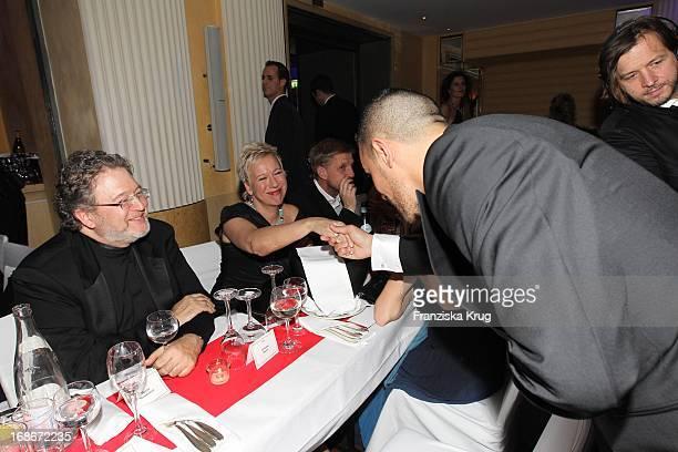 Doris Dorrie and husband Helge Weindler greet rapper Bushido at 37th German Filmball at Hotel Bayerischer Hof in Munich on 160110