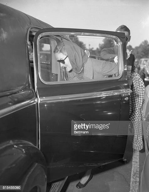 Doris Duke arrives via American Airlines at LaGuardia Field from Los Angeles wearing her traditional dark glasses and refusing to stop for newsmen...