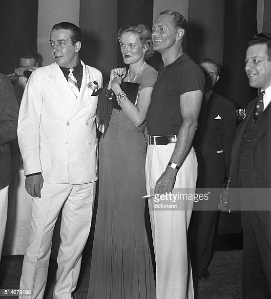 Doris Duke heiress of the Duke tobacco fortune attends the Burlesque Ball at the Waldorf Astoria Hotel with her husband James Cromwell and Jack Hearst
