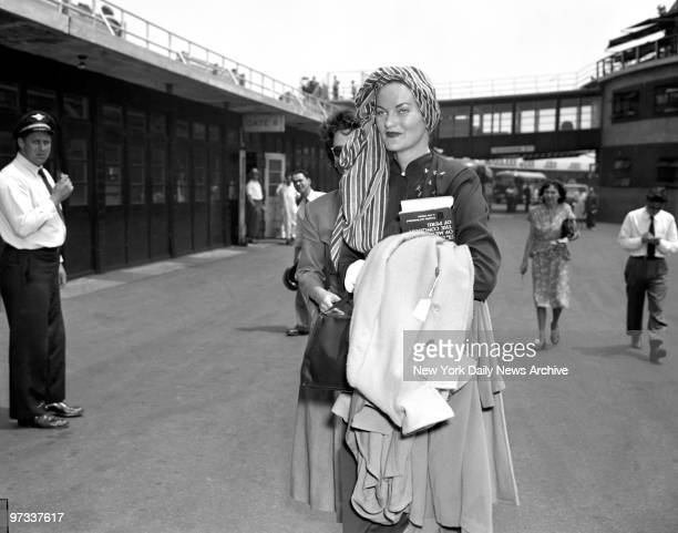 Doris Dunks Rumors Sporting a flashy turban Doris Duke Rubirosa arrives at LaGuardia Field She denied rumors that she and her hubby Dominican...