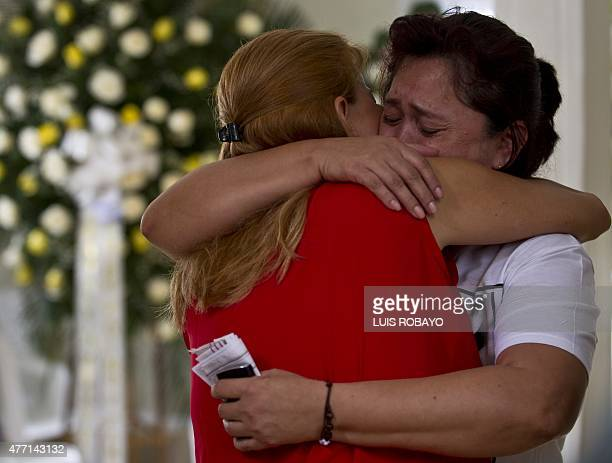 Doris Garcia Cardona mother of police officer Juan David Marmolejo is embraced by a relative during his funeral in Cali Valle del Cauca department...