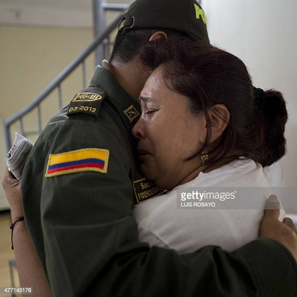 Doris Garcia Cardona mother of police officer Juan David Marmolejo is embraced by a police officer during his funeral in Cali Valle del Cauca...