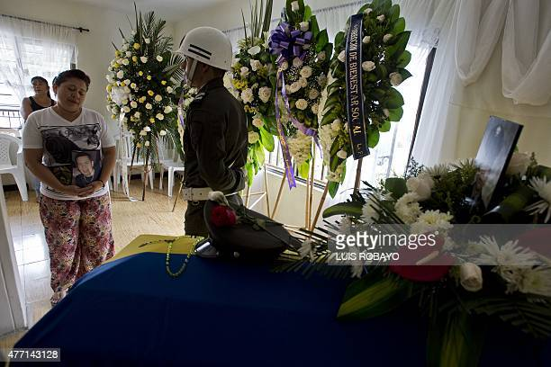 Doris Garcia Cardona mother of police officer Juan David Marmolejo mourns next to his coffin during his funeral in Cali Valle del Cauca department...