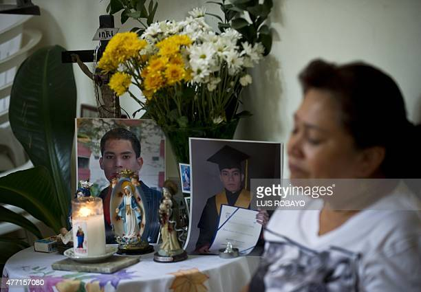 Doris Garcia Cardona mother of police officer Juan David Marmolejo mourns during his funeral in Cali Valle del Cauca department Colombia on June 14...