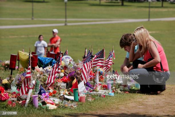 Doris Hodges and her son Josh a Virginia Tech junior look over mementos photos and array of condolences left at a memorial to the victims of the...