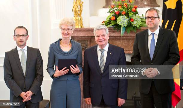 Doris Koenig poses after her swearingin as new judge at German Federal Constitutional Court next to German Justice Minister Heiko Maas German...