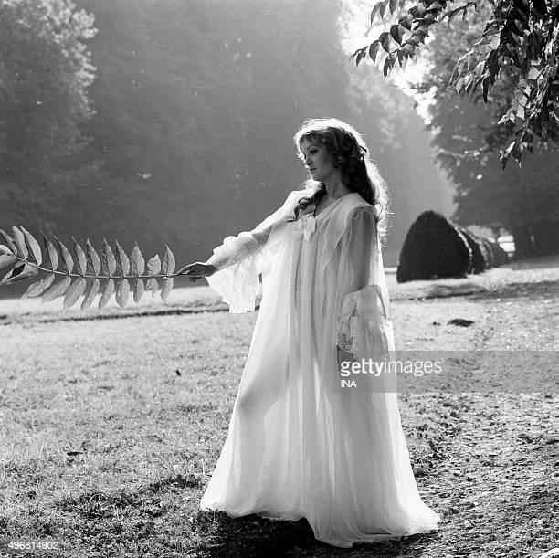 Doris Kunstmann in nightdress striking the pose in a garden
