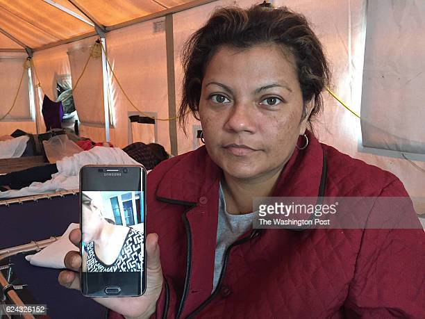 Doris Medina holds up a picture showing the bruises on her neck from an attempted sexual assault by a 'coyote' smuggling guide in Mexico Medina who...