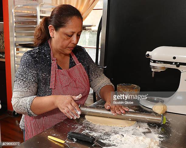 Doris Montoya rolls out the dough for the alfajores a Peruvian cookies in her home bakery called Doris Peruvian Pastries in Marlborough Mass on Nov...