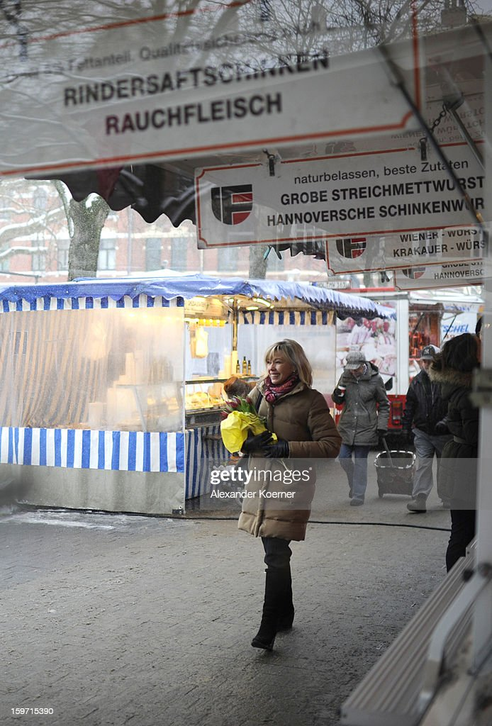 Doris Schroeder-Koepf, the wife of former German Chancellor Gerhard Schroeder, distributes flowers and speaks to passers-by while campaigning in elections in the state of Lower Saxony on January 18, 2013 in Hanover, Germany. Schroeder-Koepf is running for office as a member of the German Social Democrats (SPD) to represent her local district in election scheduled for this Sunday.