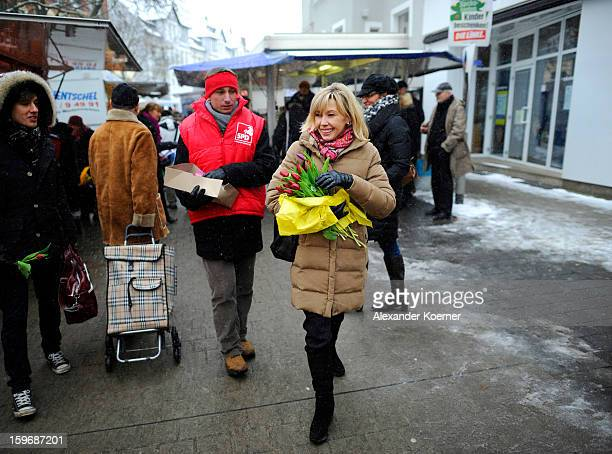 Doris SchroederKoepf who is the wife of former German Chancellor Gerhard Schroeder distributes flowers and speaks to passersby while campaigning in...