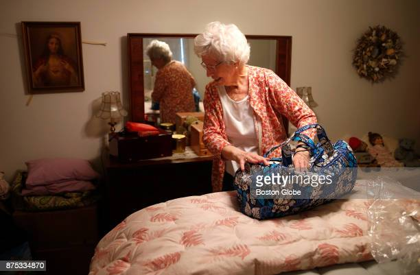 Doris Toohey packs a bag as she prepares for her temporary move to the Marriott Residence from her condo in the Brighton neighborhood of Boston on...
