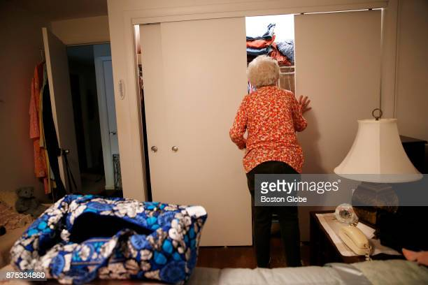Doris Toohey peers into her closet as she considers what to bring with her as she prepares for her temporary move to the Marriott Residence from her...