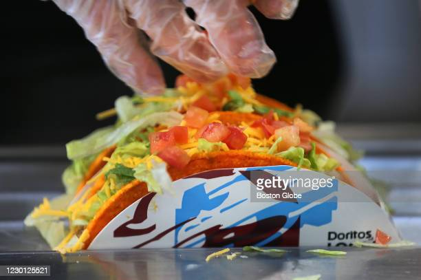 Doritos tacos are made at the new Taco Bell Cantina in Brookline, MA on Dec. 4, 2020. The new Taco Bell on Boston University's campus on Commonwealth...