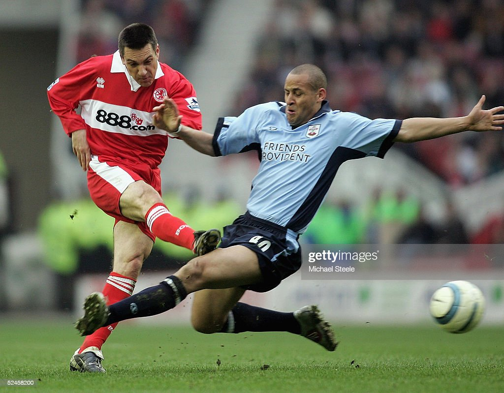 Doriva of Middlesbrough fires off a shot despite the attentions of Nigel Quashie during the Barclays Premiership match between Middlesbrough and Southampton at the Riverside Stadium on March 20, 2005 in Middlesbrough, England