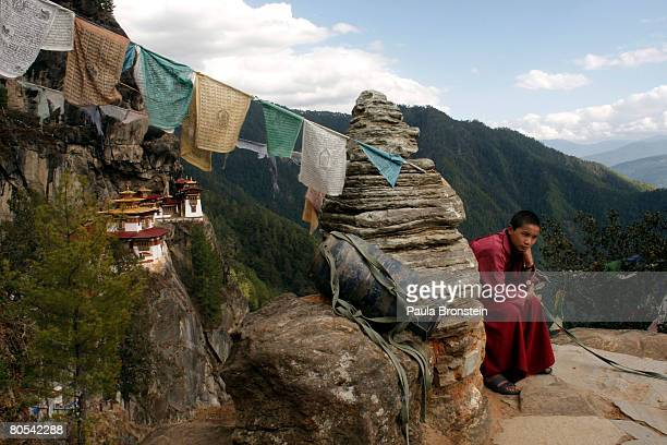 Dorji rests after walking from the Taktshang monastery April 3 2008 outside of Paro Bhutan Dorji is one of a handful of monks living at one of the...