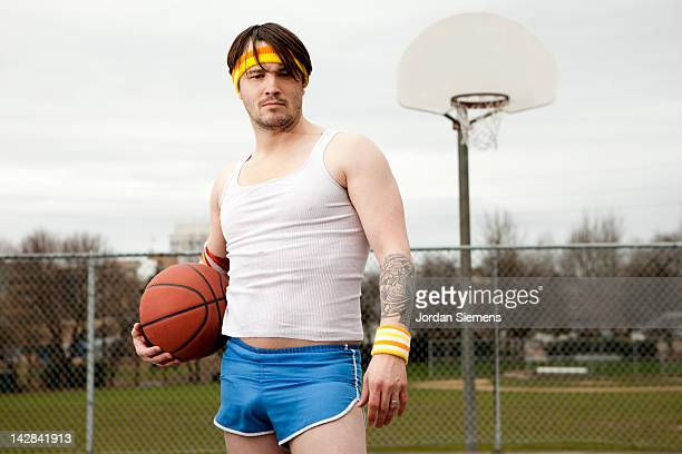 dork  standing with basketball under his arm. - hair band stock pictures, royalty-free photos & images
