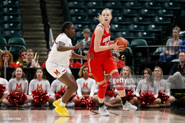 Dorka Juhasz of the Ohio State Buckeyes looks to pass the ball in the game against the Maryland Terrapins during the Big Ten Women's Basketball...