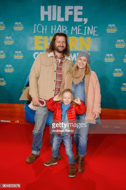 Dorkas Kiefer with partner Sascha and son Sam attend the premiere of 'Hilfe ich hab meine Eltern geschrumpft' at Cinedom on January 14 2018 in...
