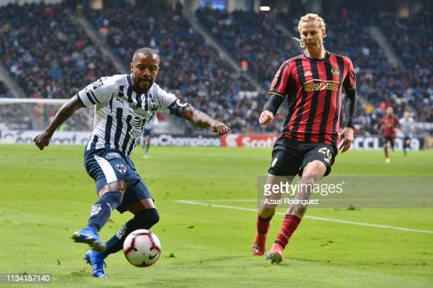 Dorlan Pabón of Monterrey drives the ball while followed by Brek Shea of Atlanta United during the quarterfinals first leg match between Monterrey...