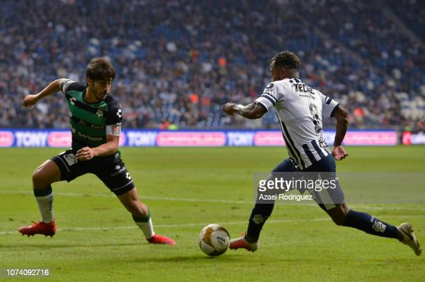 Dorlan Pabón of Monterrey fights for the ball with José Abella of Santos during the quarter finals first leg match between Monterrey and Santos...