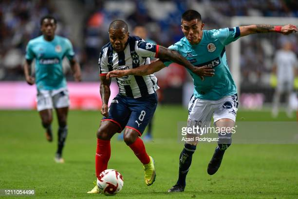 Dorlan Pabón of Monterrey fights for the ball with Luis Reyes of San Luis during the 9th round match between Monterrey and Atletico San Luis as part...