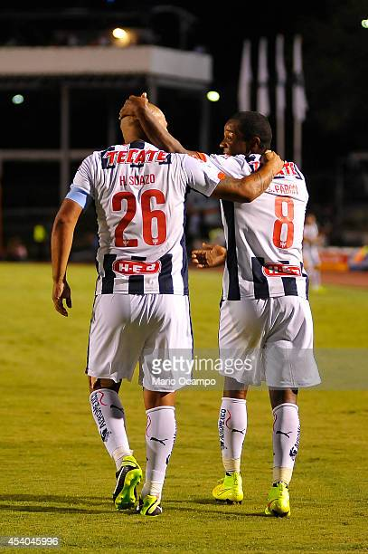 Dorlan Pabon of Monterrey celebrates with Humberto Suazo after scoring during a match between Monterrey and Puebla as part of 6th round Apertura 2014...