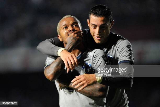 Dorlan Pabon of Monterrey celebrates with teammate Rogelio Funes Mori after scoring the second goal of his team during the second round match between...