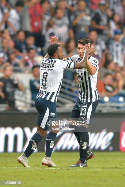 Dorlan Pabon of Monterrey celebrates with teammate Stefan Medina after scoring his teams first goal during the 9th round match between Monterrey and...