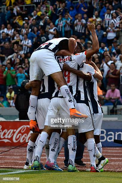 Dorlan Pabon of Monterrey celebrates with teammates after scoring his team's first goal during a match between Monterrey and America as part of 13th...
