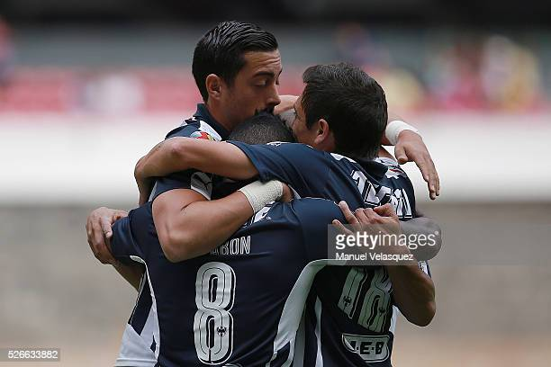 Dorlan Pabon of Monterrey celebrates with teammates after scoring the first goal of his team during the 16th round match between America and...