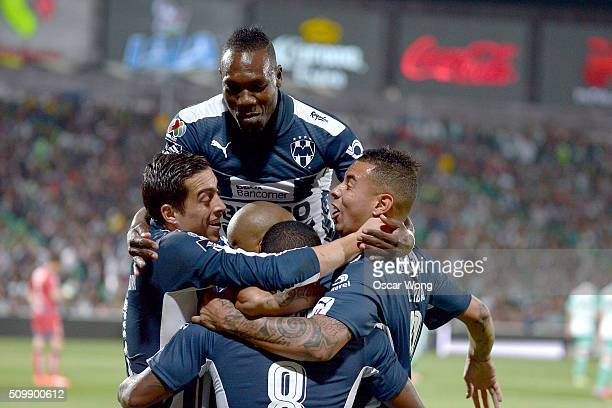 Dorlan Pabon of Monterrey celebrates with teammtes after scoring the first goal of his team during a 6th round match between Santos Laguna and...