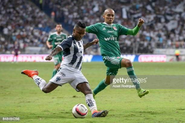 Dorlan Pabon of Monterrey competes for the ball with Ulises Cardona of Atlas during the 9th round match between Monterrey and Atlas as part of the...