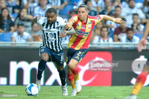 Dorlan Pabon of Monterrey fights for the ball with Efrain Velarde of Morelia during the 7th round match between Monterrey and Morelia as part of the...
