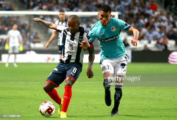 Dorlan Pabon of Monterrey fights for the ball with German Berterame of San Luis during the 9th round match between Monterrey and Atletico San Luis as...