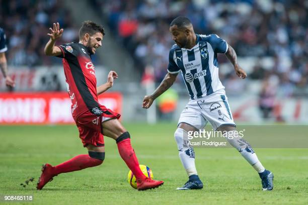 Dorlan Pabon of Monterrey fights for the ball with Jose Rivero of Tijuana during the third round match between Monterrey and Tijuana as part of...