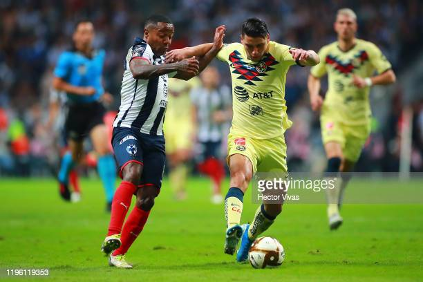 Dorlan Pabon of Monterrey struggles for the ball against Jorge Sánchez of America during the Final first leg match between Monterrey and America as...