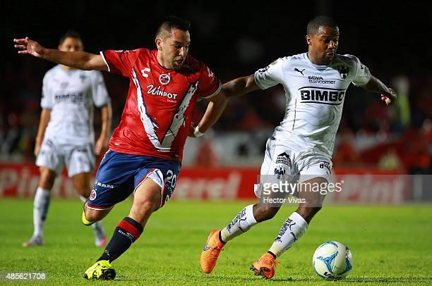 Dorlan Pabon of Monterrey struggles for the ball with Fernando Meneses of Veracruz during a 7th round match between Veracruz and Monterrey as part of...
